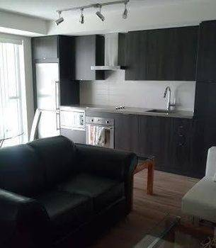 Hotel E.S.I Furnished Suites at Fly Condos