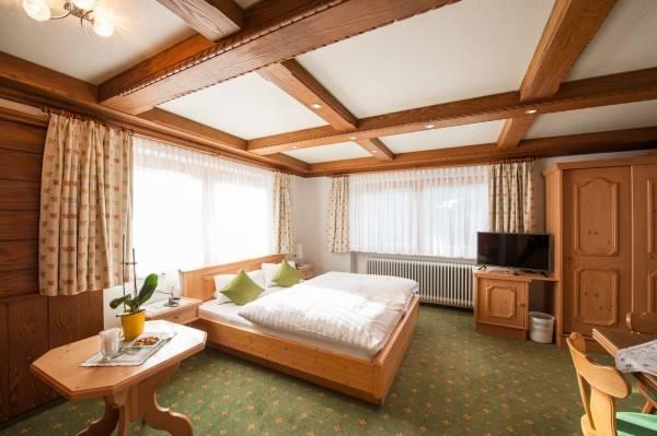 Hotel Alpenperle - Zimmer / Ferienwohnungen