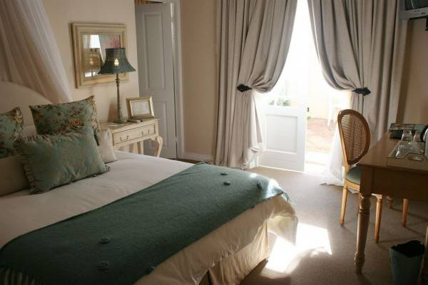 Hotel Goble Palms Guest Lodge & Urban Retreat